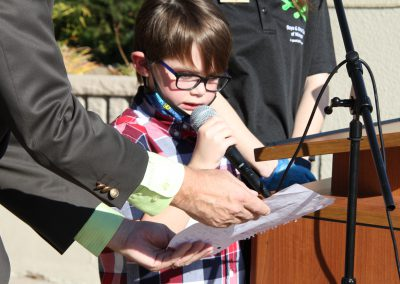 Boy holding ribbon for cutting ceremony
