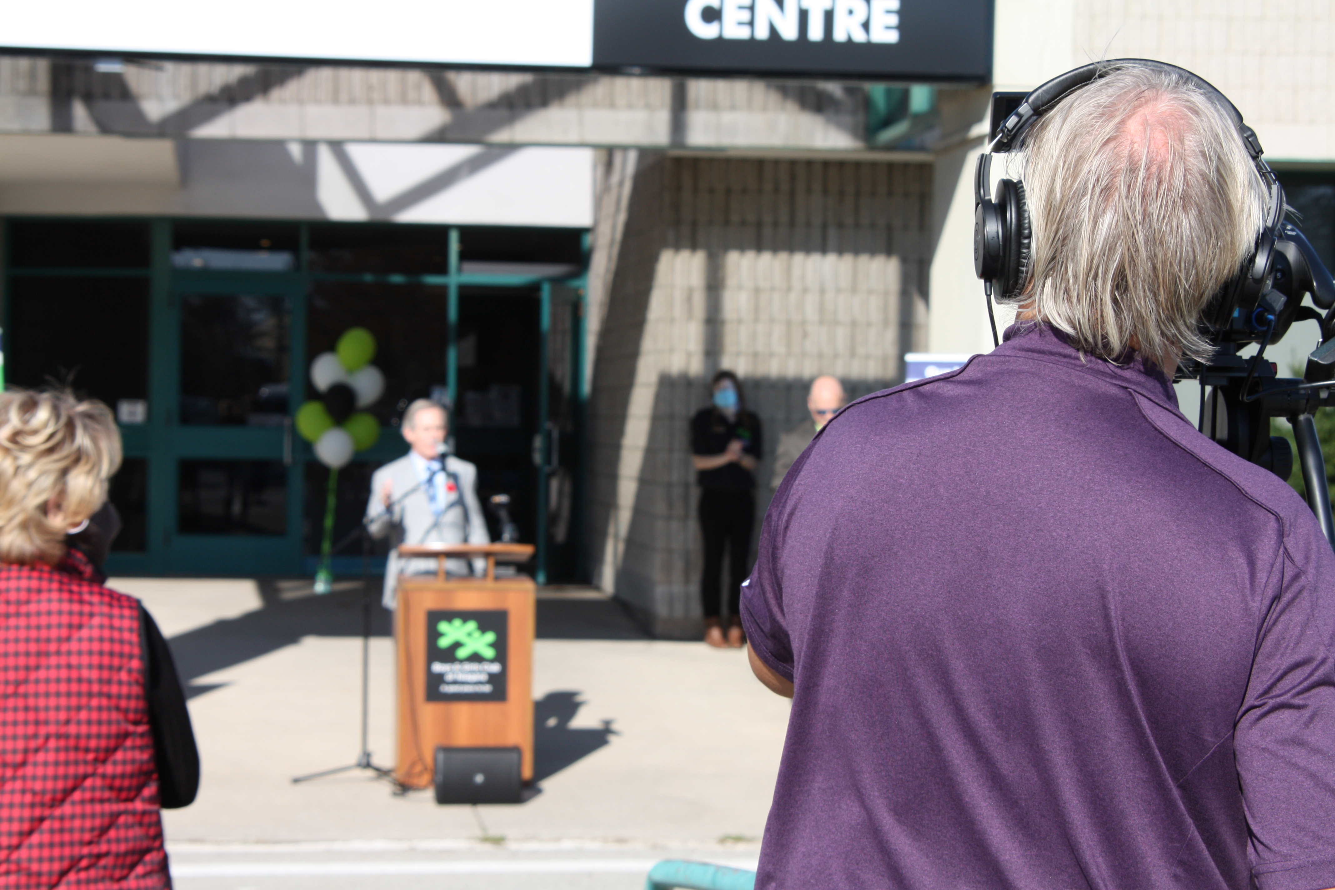 Wayne Redekop at podium for EJ Freeland ribbon cutting ceremony