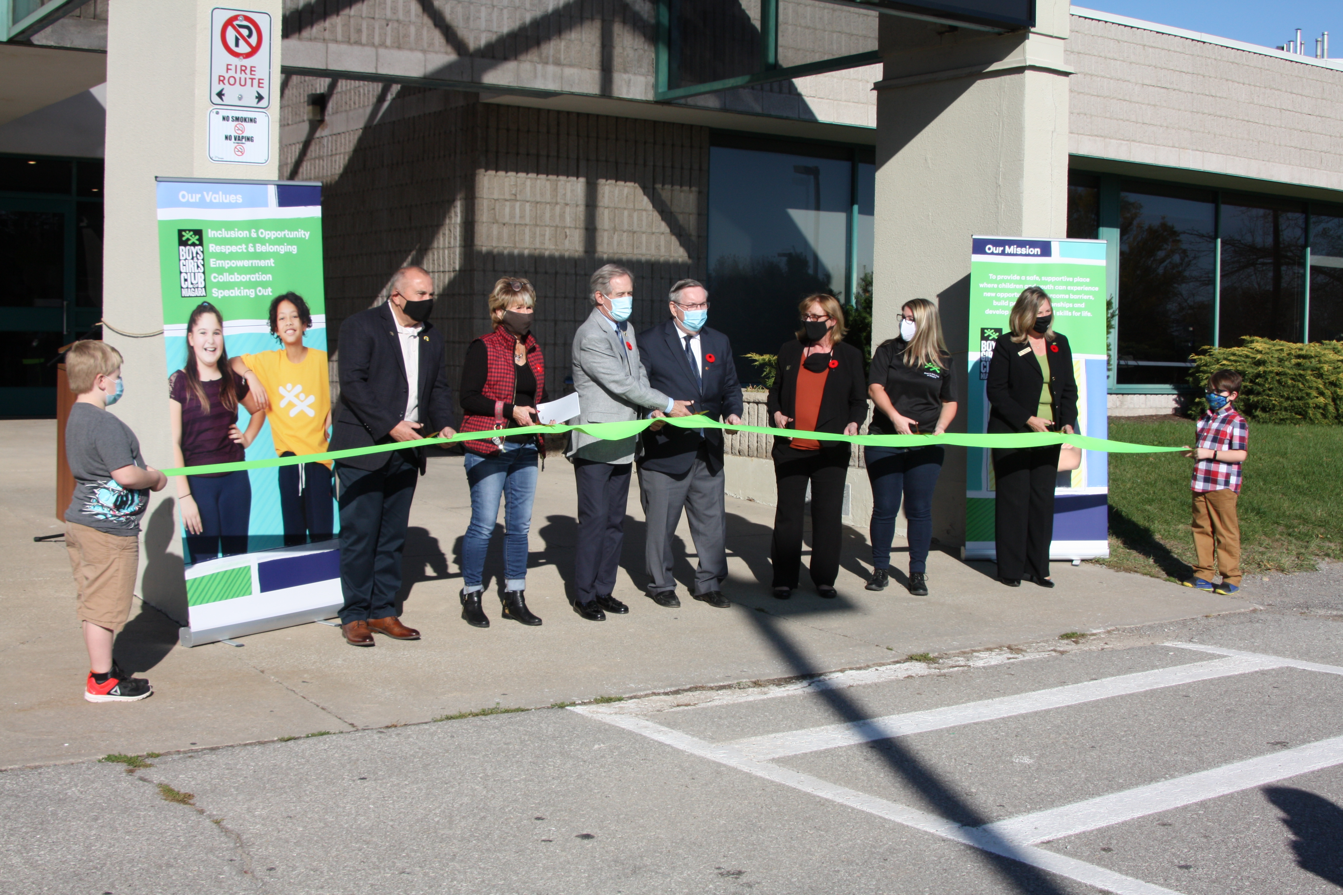 Cutting of the ribbon for EJ Freeland Grand Opening and 60th celebration